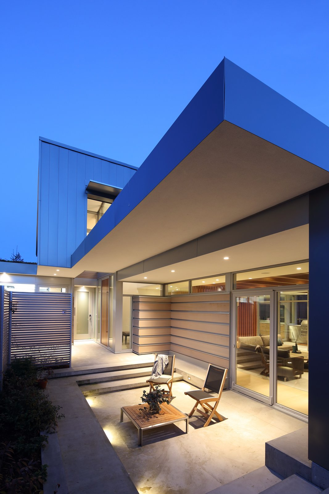Exterior, House Building Type, Wood Siding Material, Metal Siding Material, Shed RoofLine, and Flat RoofLine Front patio  The Edge House