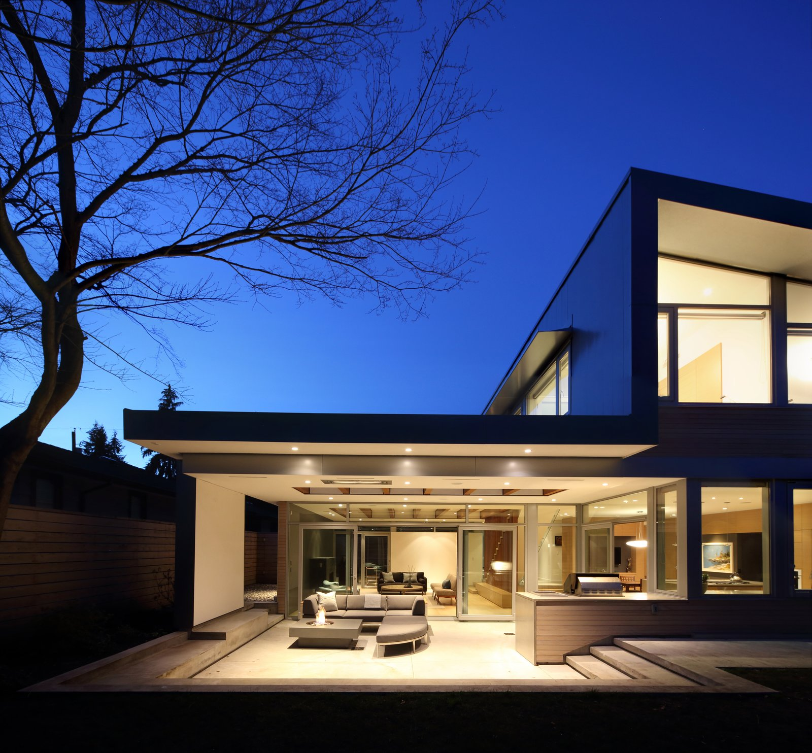 Exterior, House Building Type, Wood Siding Material, Shed RoofLine, Metal Siding Material, and Flat RoofLine Rear patio  The Edge House