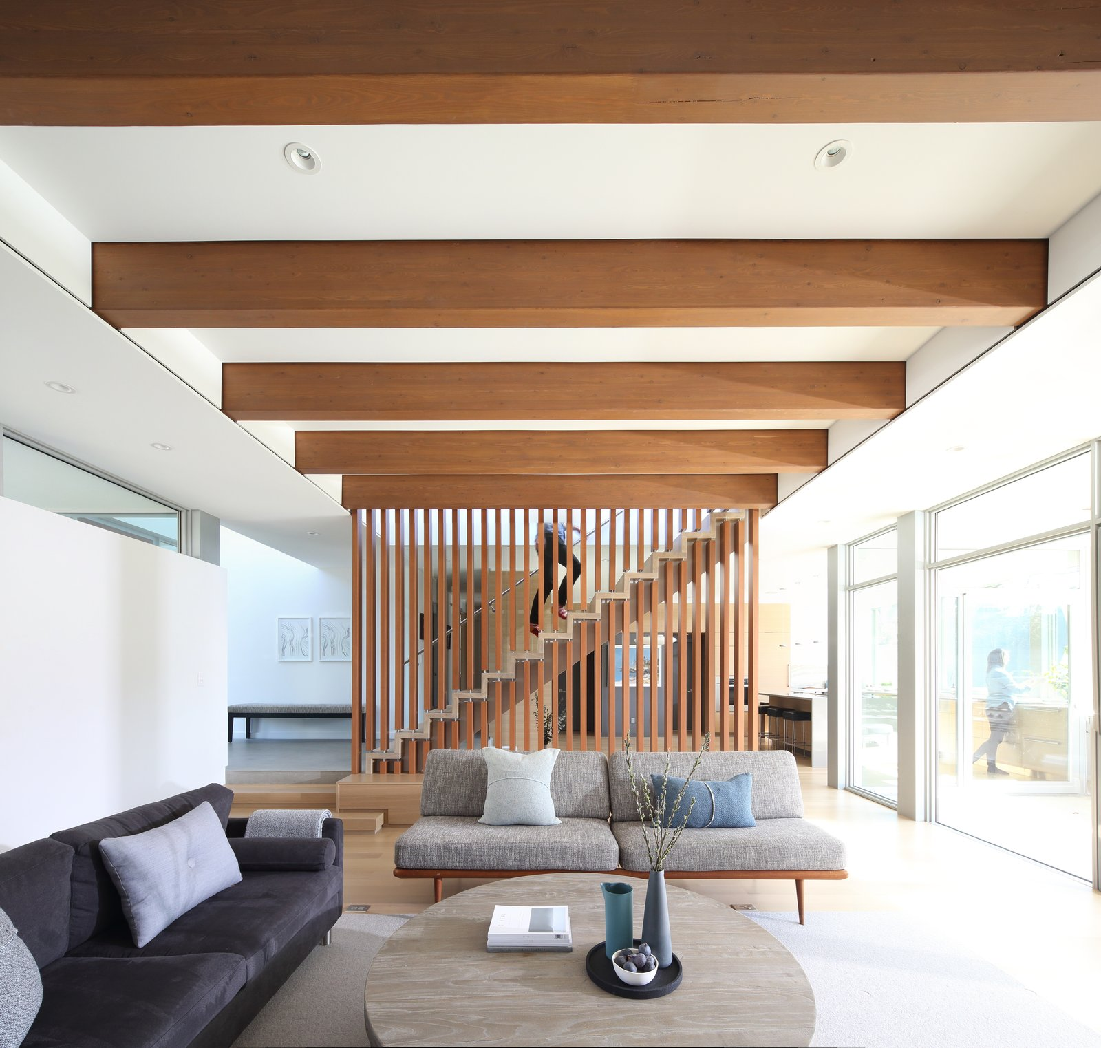 Living Room, Sofa, Coffee Tables, Ceiling Lighting, and Light Hardwood Floor Living room  The Edge House