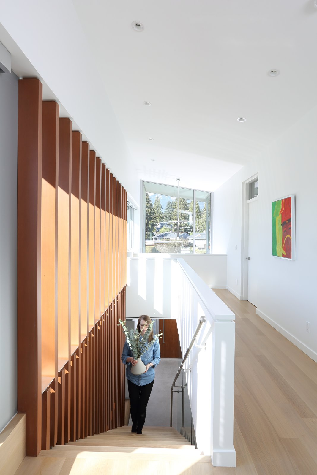 Staircase, Wood Tread, and Metal Railing Stair to upper level  The Edge House