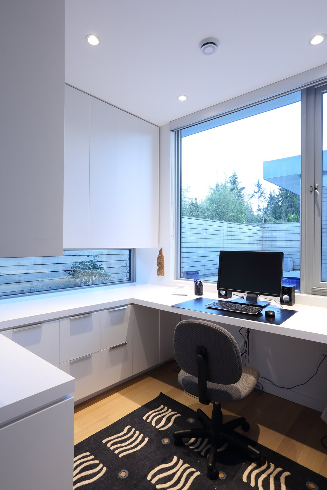 Office, Study Room Type, Chair, Storage, Bookcase, Desk, Light Hardwood Floor, and Shelves Office  The Edge House