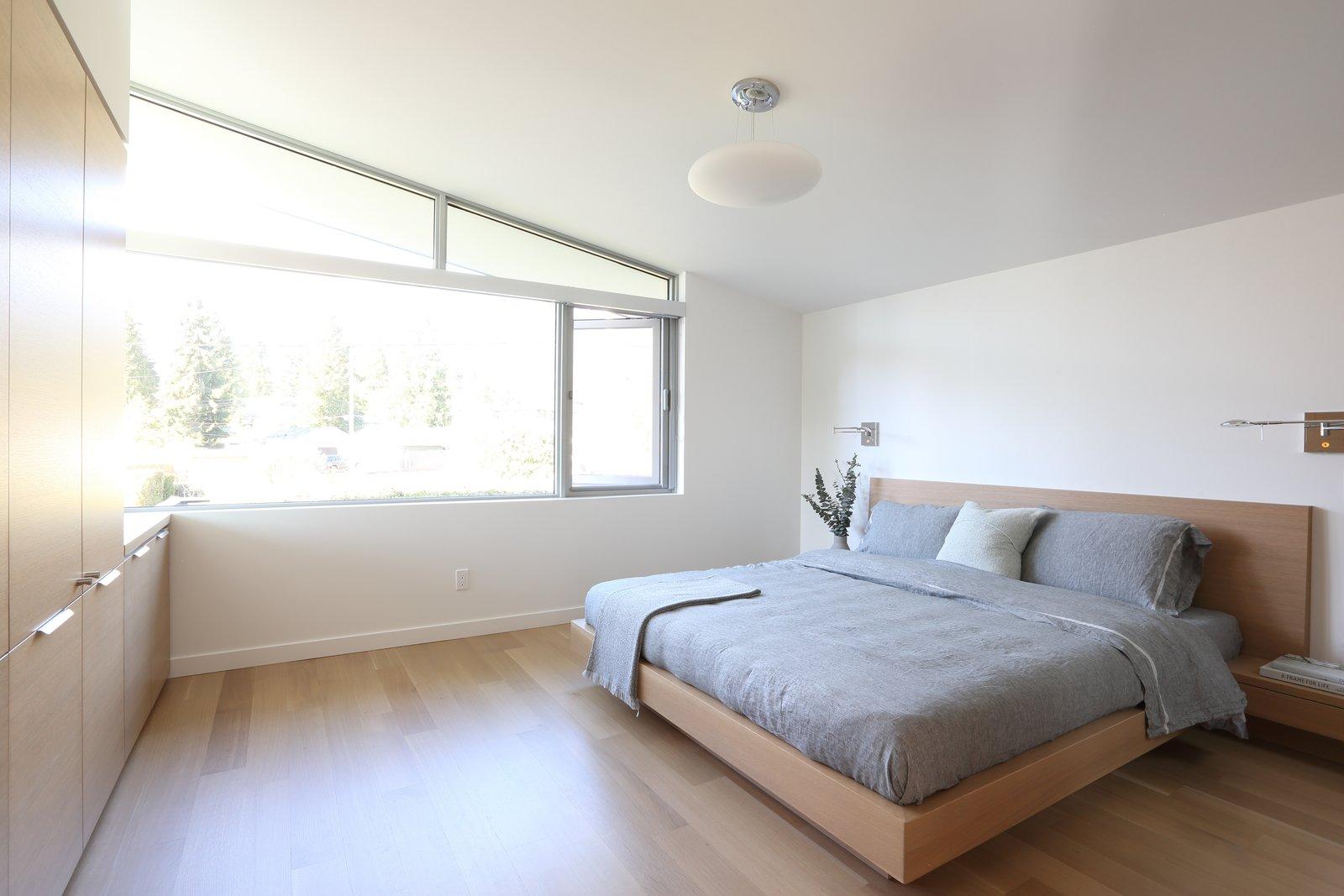Bedroom, Bed, Wardrobe, Storage, Wall Lighting, Light Hardwood Floor, and Pendant Lighting Master bedroom  The Edge House