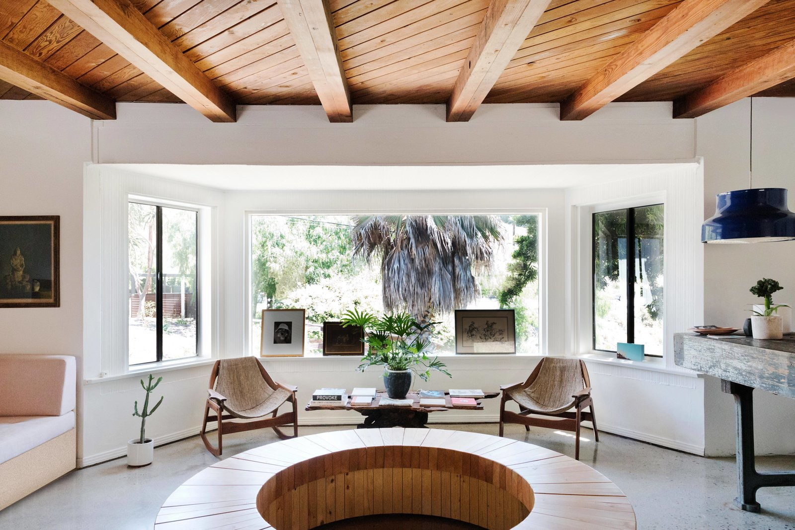 Living Room, Sofa, Pendant Lighting, Chair, Coffee Tables, and Terrazzo Floor Check-in features design-conscious updates, such as a Jerry Johnson sling rocker and chair and a wood bar sofa from Early Work.  Best Photos from Do Malibu in Style With the Native Hotel, a Rejuvenated Hollywood Favorite