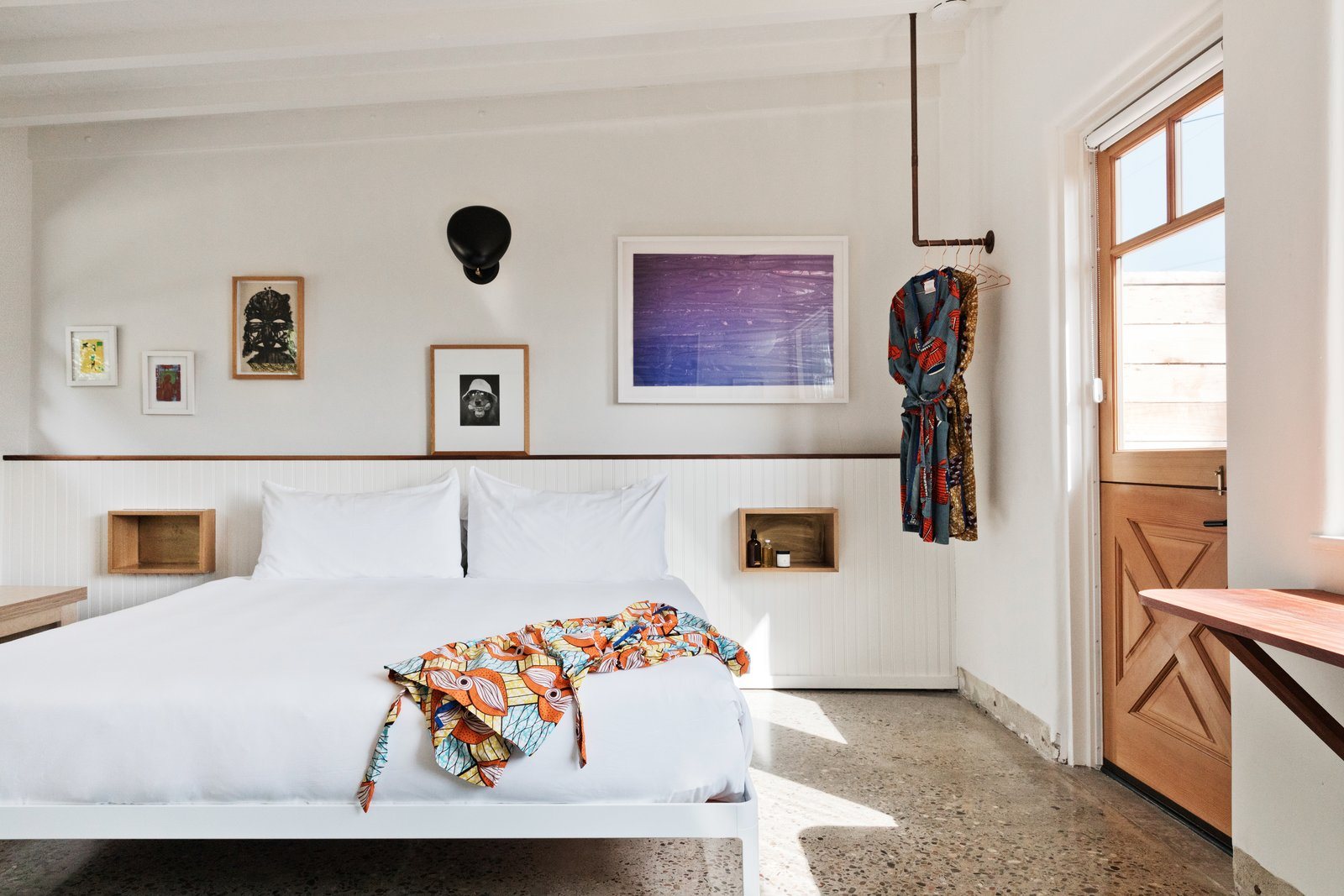 Bedroom, Bed, Wall Lighting, Shelves, and Terrazzo Floor As if you needed another excuse to visit Malibu, Native beckons as a stylish getaway with a storied past. Rooms start at $400 a night.  Best Photos from Do Malibu in Style With the Native Hotel, a Rejuvenated Hollywood Favorite