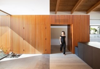 Douglas fir cladding that leads into the foyer conceals the garage, which is a 24-foot-wide, top-hung, bi-fold door.