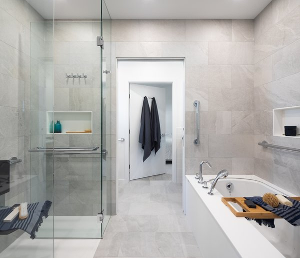 A zero-threshold shower and safety bars in the bathroom connecting two master bedrooms are thoughtful touches meant for aging in place.