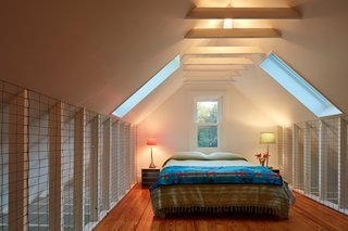 Wire netting surrounding the sleeping loft serves as a gentle nod to the property's heritage.