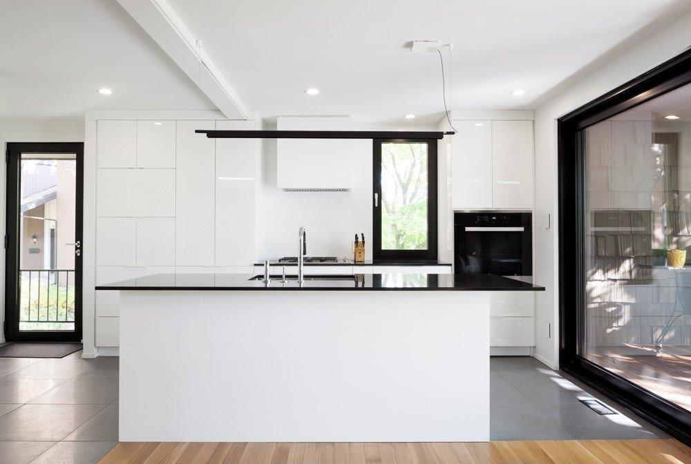 Kitchen, Laminate, White, Laminate, Ceramic Tile, Wall Oven, Drop In, Ceiling, and Undermount Kitchen  Best Kitchen White Laminate Photos from Résidence de la rue de l'Espéranto