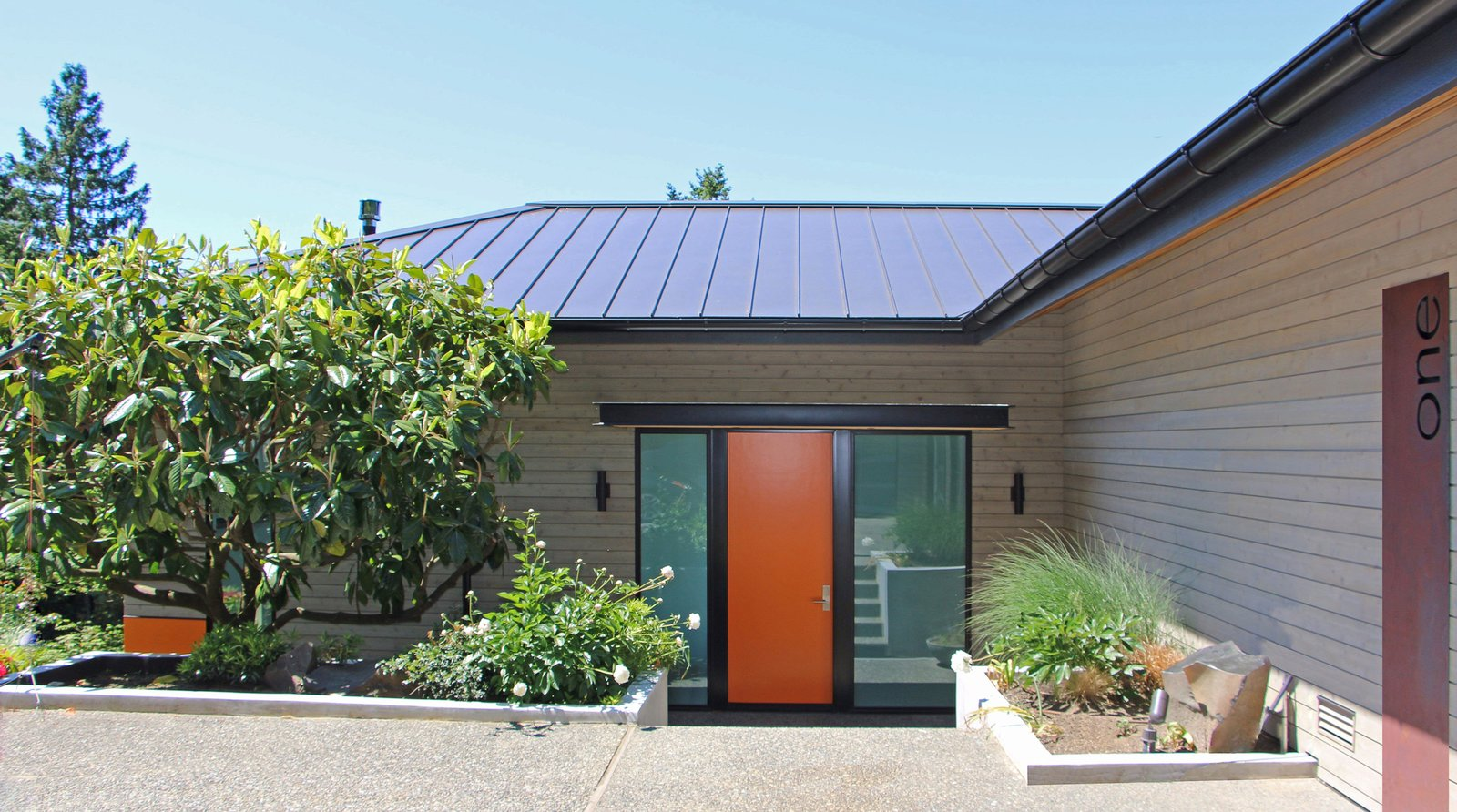 Brooks Front Entry Tagged: Exterior, House, Metal Roof Material, Wood Siding Material, and Hipped RoofLine.  Brooks Remodel