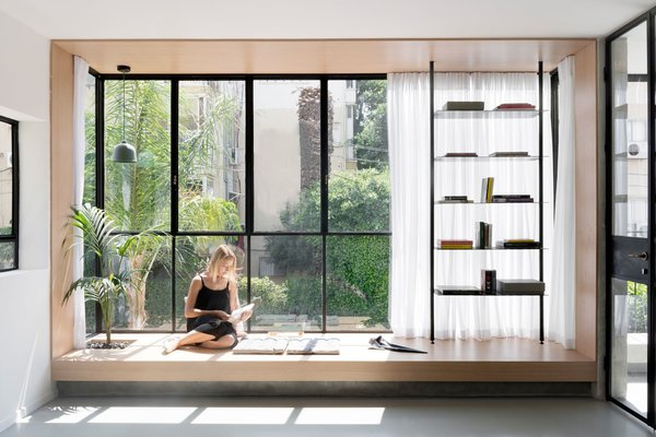 an airy space punctuated by delicate black frames