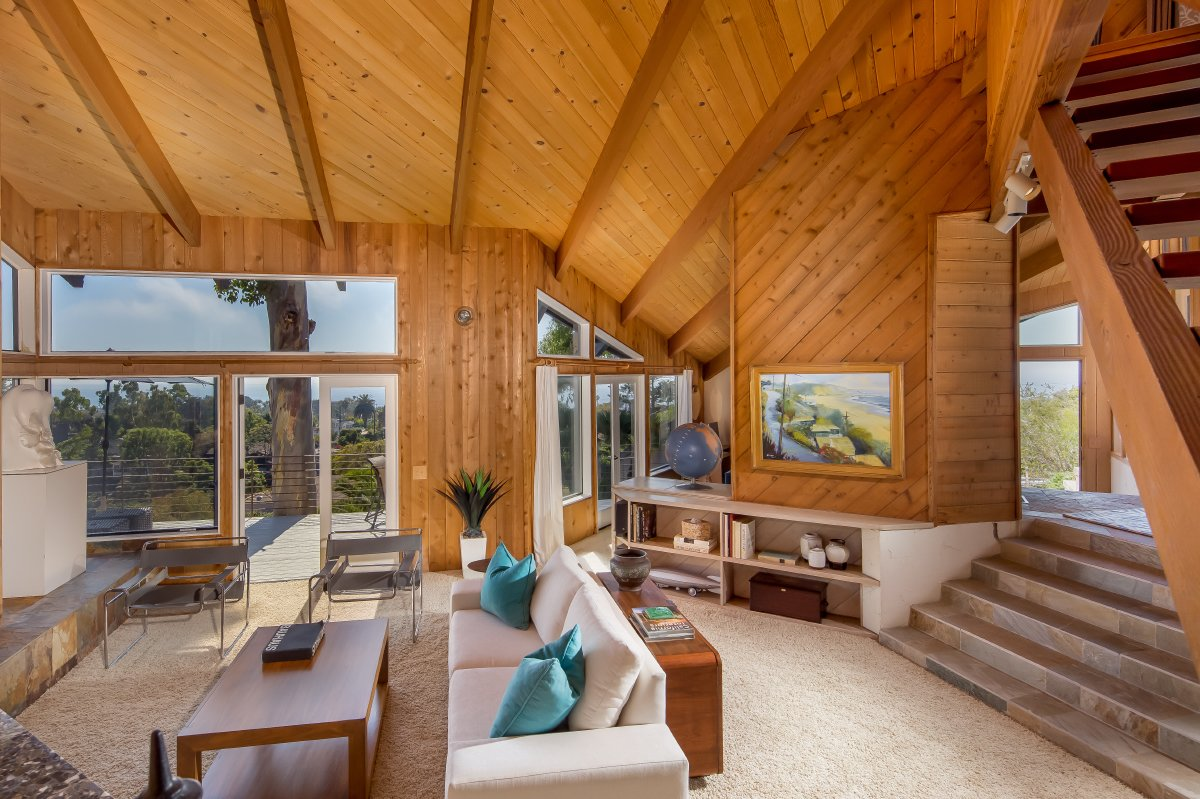 Living Room, Sofa, Chair, Coffee Tables, Console Tables, Bookcase, Wall Lighting, Track Lighting, Slate Floor, and Standard Layout Fireplace An Expansive Use of Wood and Glass  J. Lamont Langworthy Design