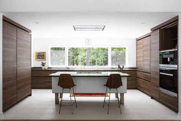 Modern kitchen features open-legged island (Leicht).