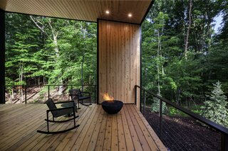 Entry porch features distant views to Lake Michigan in winter, and complete privacy in summer.