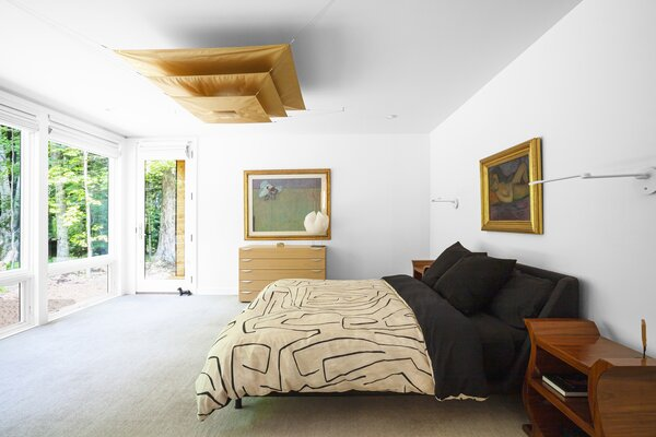 Master bedroom features Ingo Maurer lighting and views to north woods.