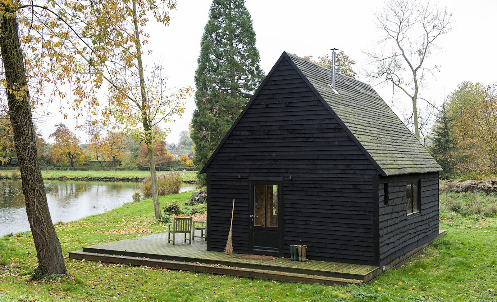 Exterior, Cabin Building Type, and Wood Siding Material London-based practice De Rosee Sa's self-built lakeside cabin recaptures the magic of childhood fairytales.   A labor of love, the 377-square-foot Woodland Cabin is a design/build project completed over multiple trips to the lakeside lot in the village of Nouvelles in southern Belgium. The architects built the cabin using locally-sourced, storm-felled timber to deepen their understanding of materials and construction.   By taking construction into their own hands and using locally-sourced materials, the team kept within the relatively tight budget of £25,000 ($32,872).    Simple yet elegant, De Rosee Sa's self-described  Photo 4 of 11 in Dwell's Top 10 Cabins of 2017 from Built on a Budget, This Belgian Cabin Is Straight Out of a Fairytale
