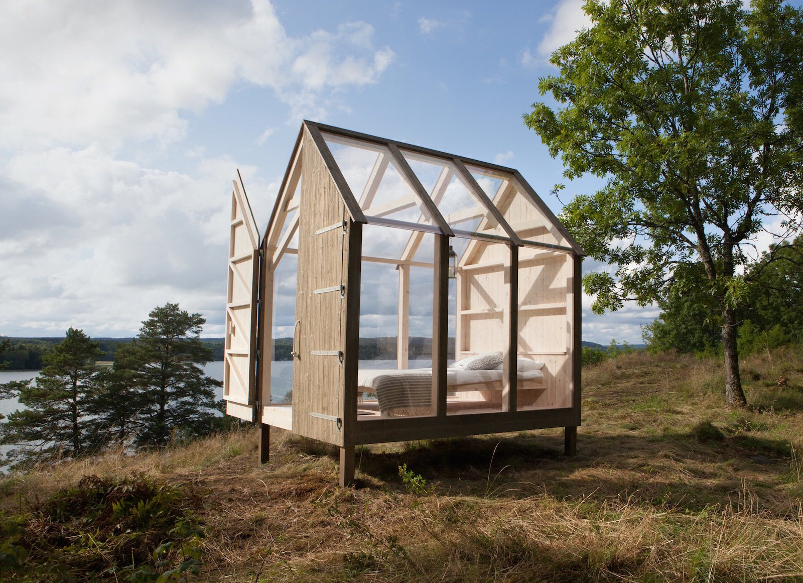 Exterior, Cabin Building Type, and Glass Siding Material With large glass panes covering the cabin's walls and gabled roof, the changing light outdoors encourages guests to sync their sleep schedules with the sun.    Photo 10 of 10 in Stressed Out? Sweden's 72 Hour Cabins Are Designed to Soothe