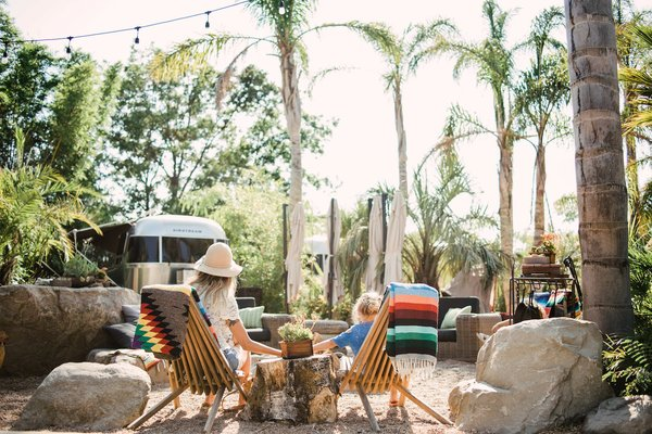 As with all great glamping destinations, the Outpost prioritizes comfort, offering plush beds with colorful quilts and all the modern tech hookups needed.