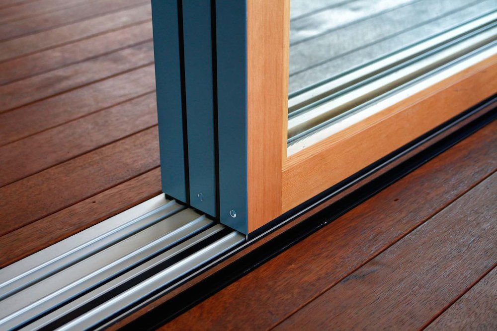 Doors, Exterior, Metal, and Sliding Door Type Weather-resistant thresholds are best for glass walls used as unprotected exterior doors.  Photo 8 of 16 in 8 Things to Consider When Choosing Retractable Glass Walls