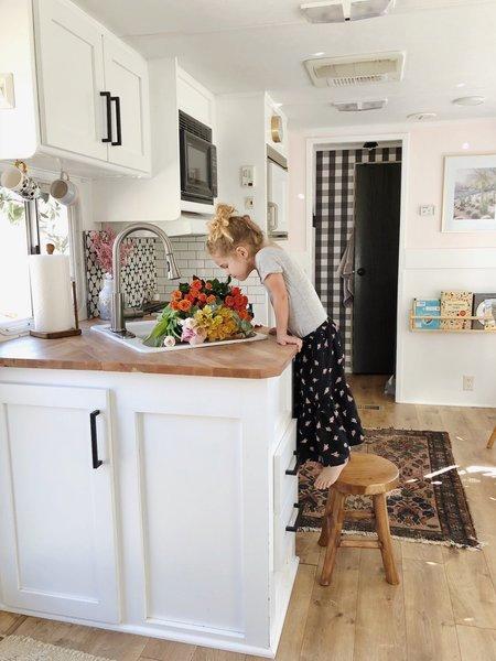 Kitchen, White, Wood, Rug, Refrigerator, Medium Hardwood, Recessed, Drop In, Microwave, and Ceramic Tile The countertop is a repurposed IKEA desktop cut to size.   Best Kitchen Medium Hardwood Wood Photos