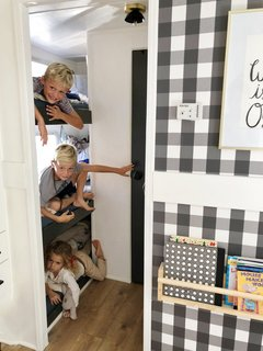 Their Three Young Children Sleep In Triple Bunk Beds The Opposite End Of RV