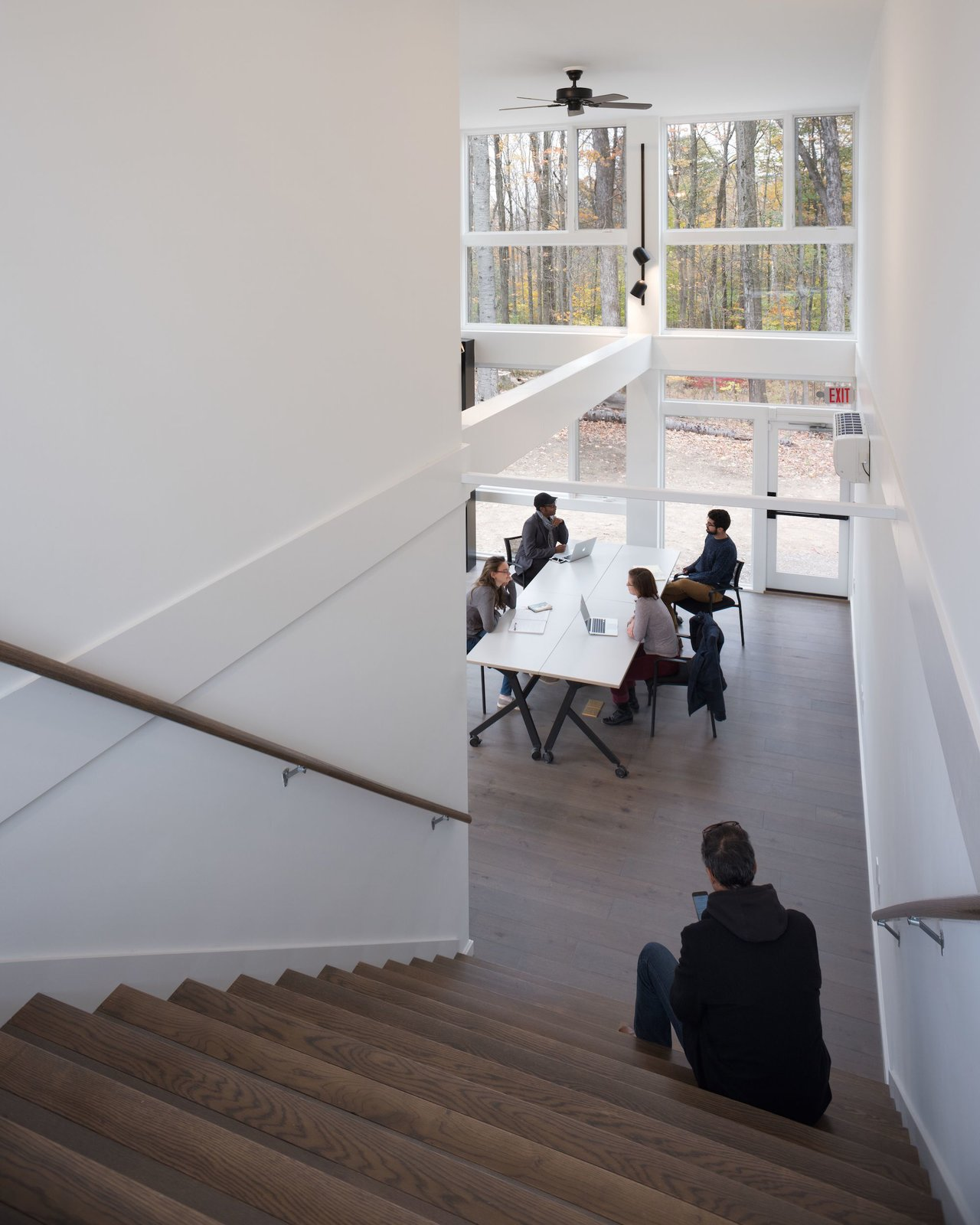 Staircase, Wood Railing, and Wood Tread The stairs double as auditorium-style seating.   Photo 7 of 12 in A Shipping Container Prefab Lab Is Built in Only 4 Hours