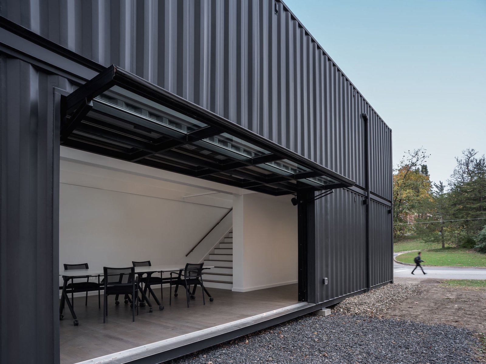 Exterior, Metal Roof Material, Shipping Container Building Type, Metal Siding Material, Flat RoofLine, and Prefab Building Type The Media Lab has been painted black to recede into the woods.    Photo 5 of 12 in A Shipping Container Prefab Lab Is Built in Only 4 Hours