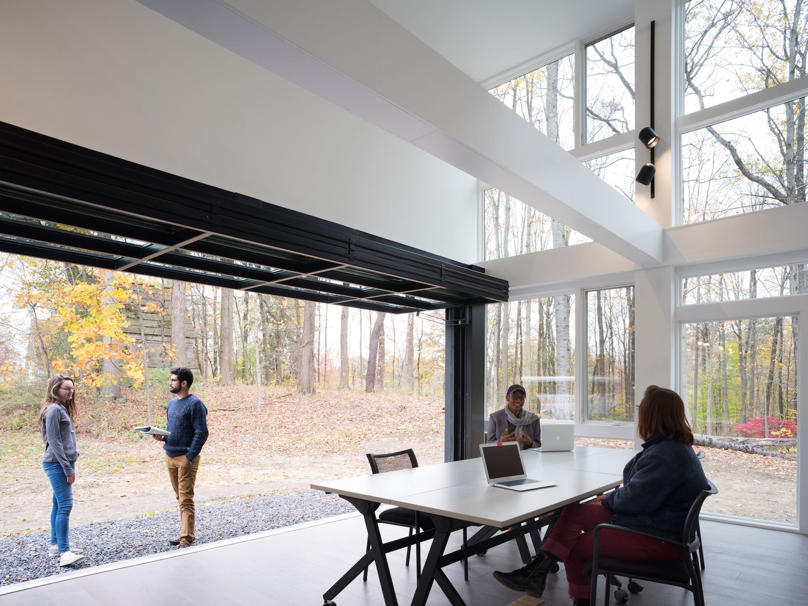 Doors, Exterior, Folding, and Metal Ample glazing blurs the distinction between indoors and out.    Best Doors Photos from A Shipping Container Prefab Lab Is Built in Only 4 Hours
