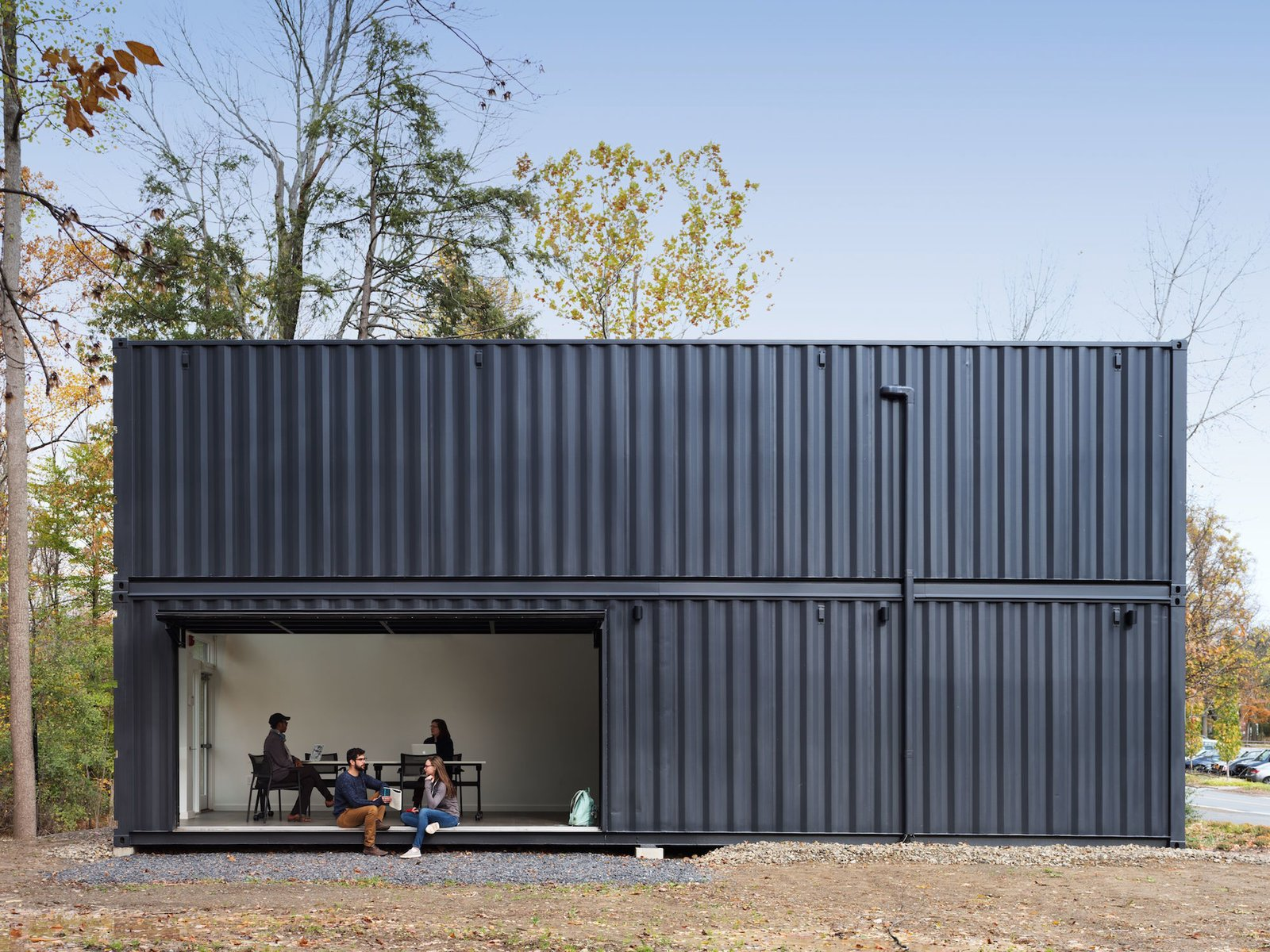 Exterior, Shipping Container Building Type, Metal Siding Material, Flat RoofLine, Metal Roof Material, and Prefab Building Type The main room opens to the quad through a large pivoting garage door.    Best Photos from A Shipping Container Prefab Lab Is Built in Only 4 Hours