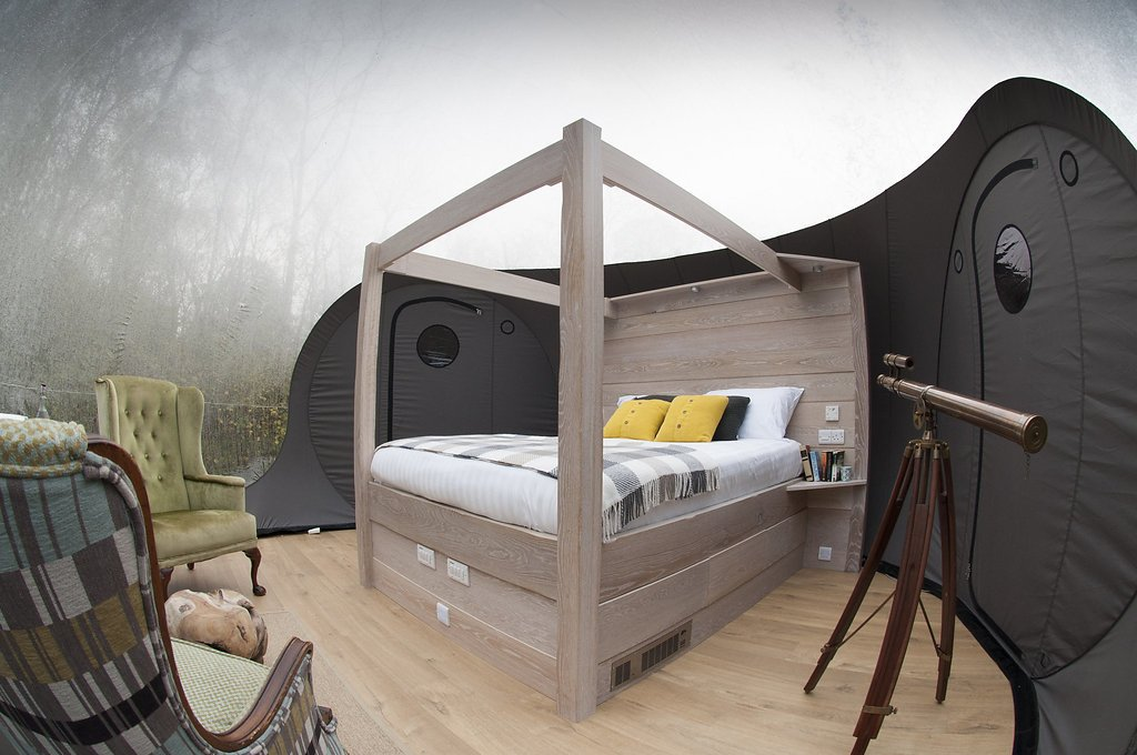 Bedroom, Bed, and Chair Underfloor heating and heated mattresses are the standard in both dome room offerings—the standard Forest Bubble Dome and the Premium Bubble Dome—that sleep two in a four-poster bed and connect to an ensuite bathroom.  Enchanting Bubble Domes in the Irish Woods