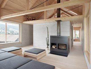 A small seating area is tucked into a loft-like space.
