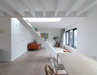 An open staircase leads to the roof deck.