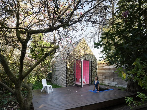 Over 4,500 3D-printed ceramic tiles clad the 120-square-foot backyard building's wooden balloon frame.