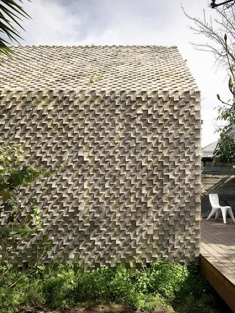 "Exterior, Tile Roof Material, Cabin Building Type, Gable RoofLine, and Tiny Home Building Type Every ""Seed Stitch"" ceramic tile is made intentionally unique.   Photo 7 of 12 in This 3D-Printed Tiny Cabin Offers a Creative Response to the Bay Area's Housing Crisis"