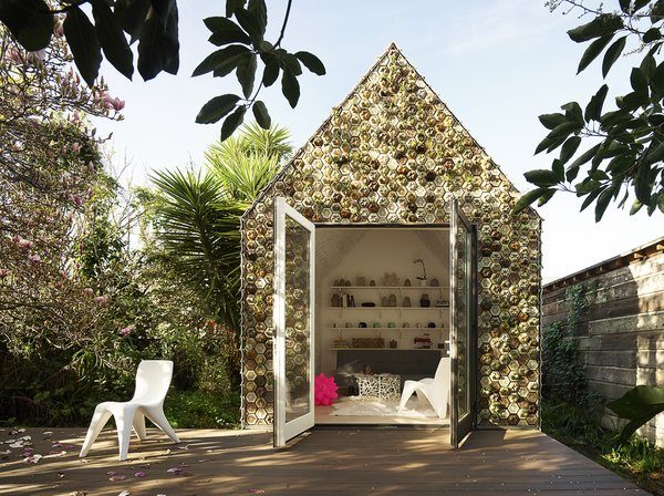 Sustainability and forward-thinking architectural techniques merge in this experimental tiny cabin clad in 3D-printed tile.
