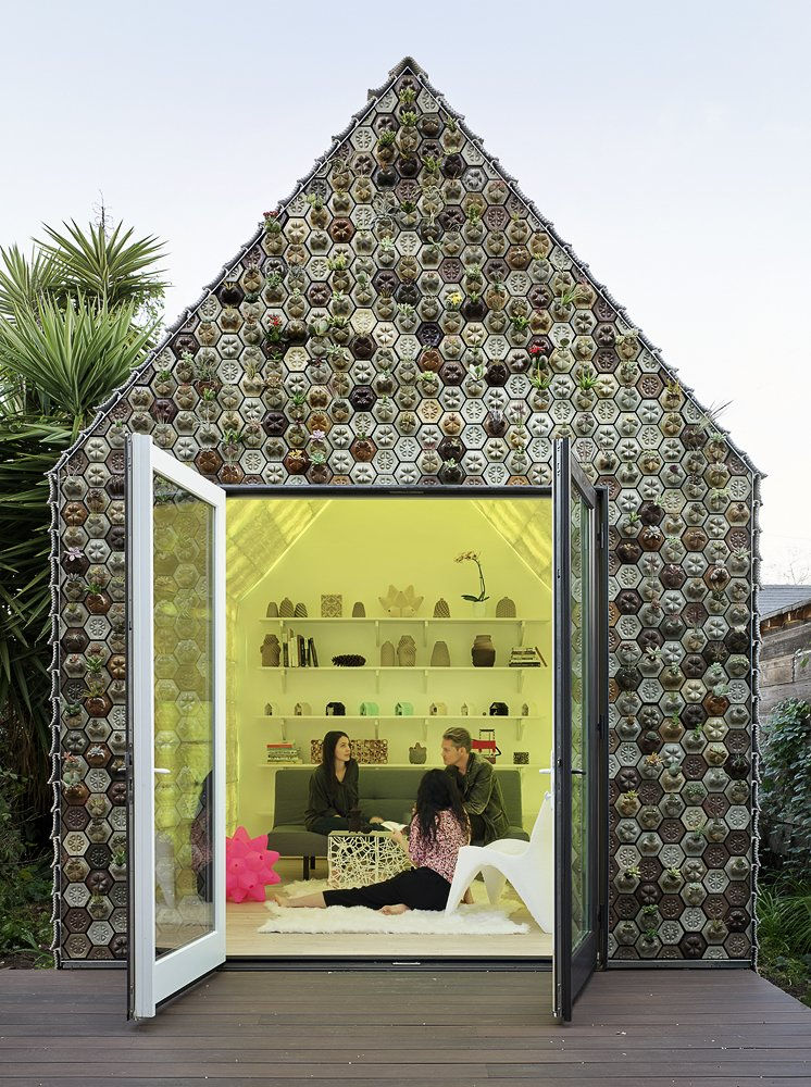 Exterior, Tile Roof Material, Gable RoofLine, Cabin Building Type, and Tiny Home Building Type The succulent planter facade is a low-maintenance living wall.  Photo 12 of 12 in This 3D-Printed Tiny Cabin Offers a Creative Response to the Bay Area's Housing Crisis