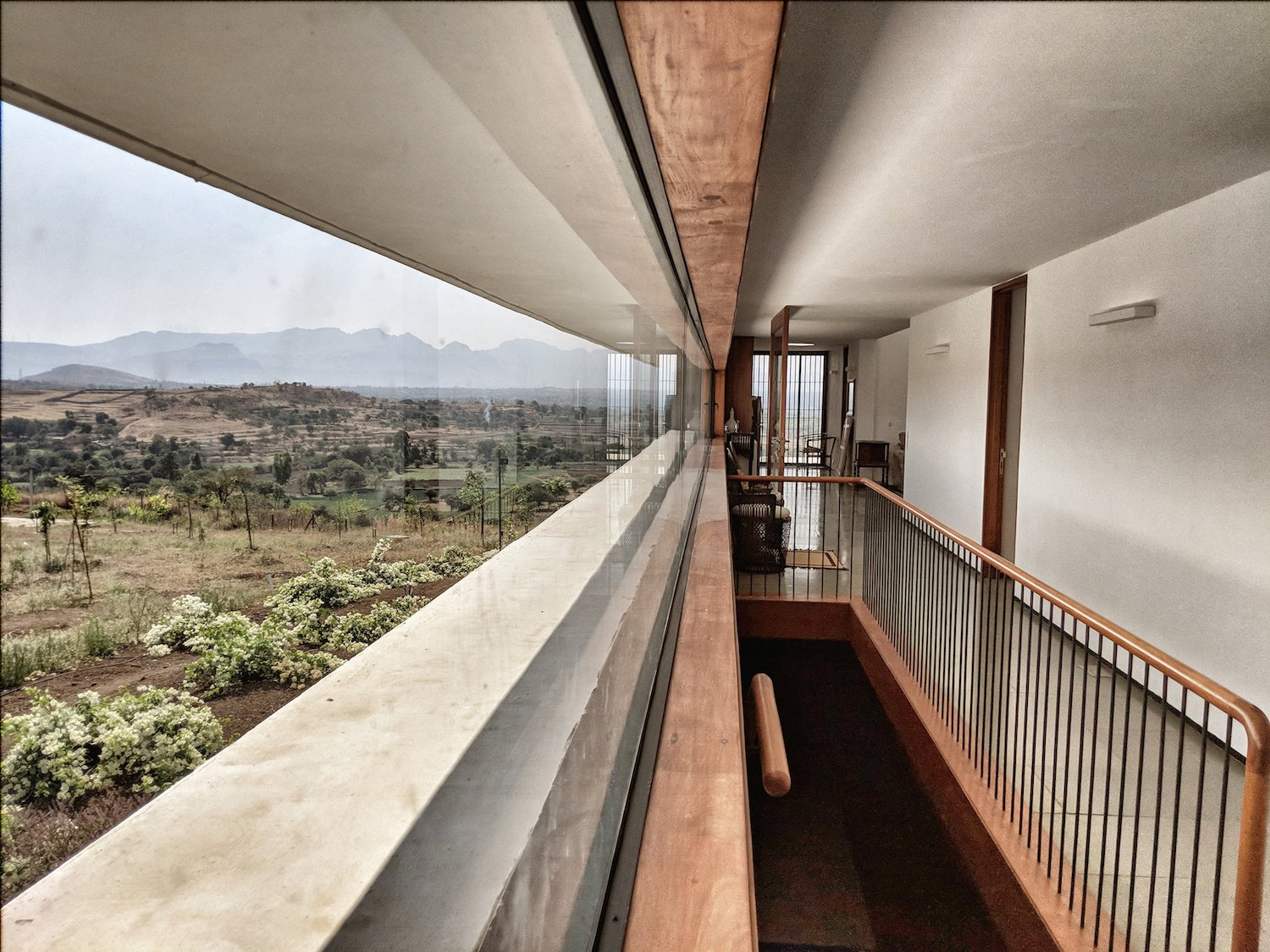 Windows, Picture Window Type, Wood, and Metal Large windows let in natural light and views from all directions.  Photo 5 of 14 in A Modern Home in India Evokes Emotion With a Giant 4-Ton Rock