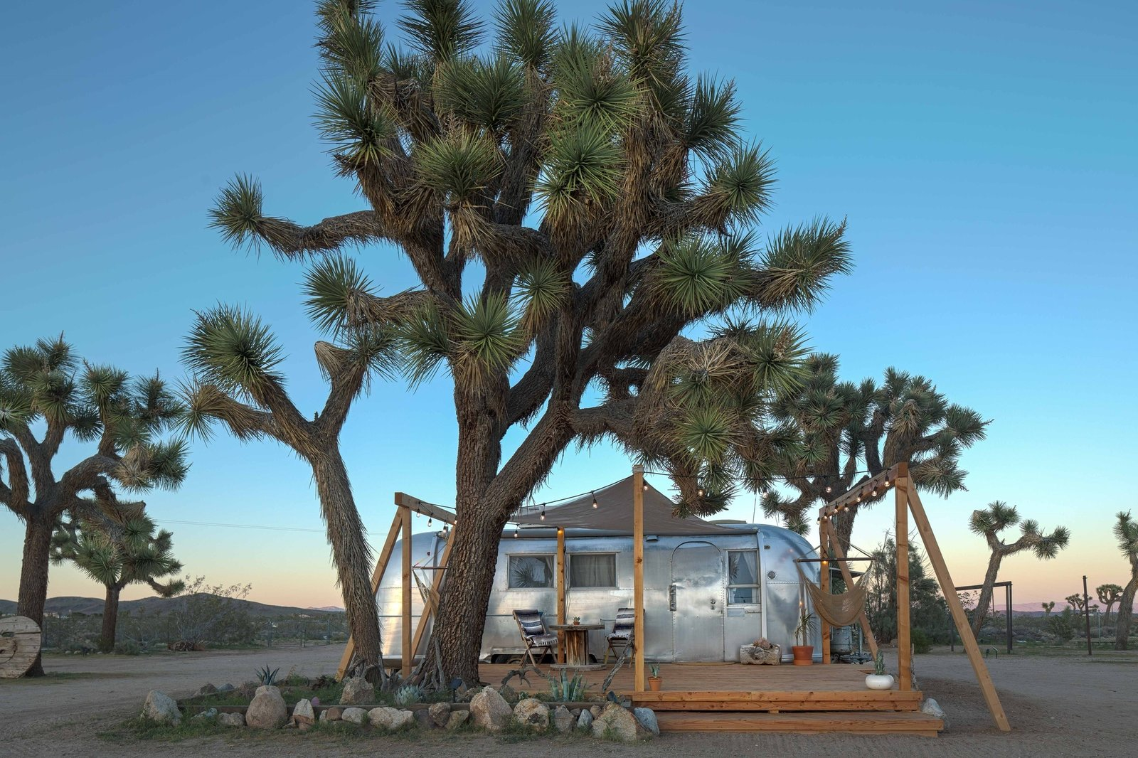 Exterior, Airstream Building Type, Metal Siding Material, Metal Roof Material, and Curved RoofLine Unsurprisingly, yoga retreats are popular at Joshua Tree Acres.   Photo 2 of 16 in Joshua Tree Is Now Home to a Chic Airstream Oasis—Featuring 4 Trailers Available to Rent
