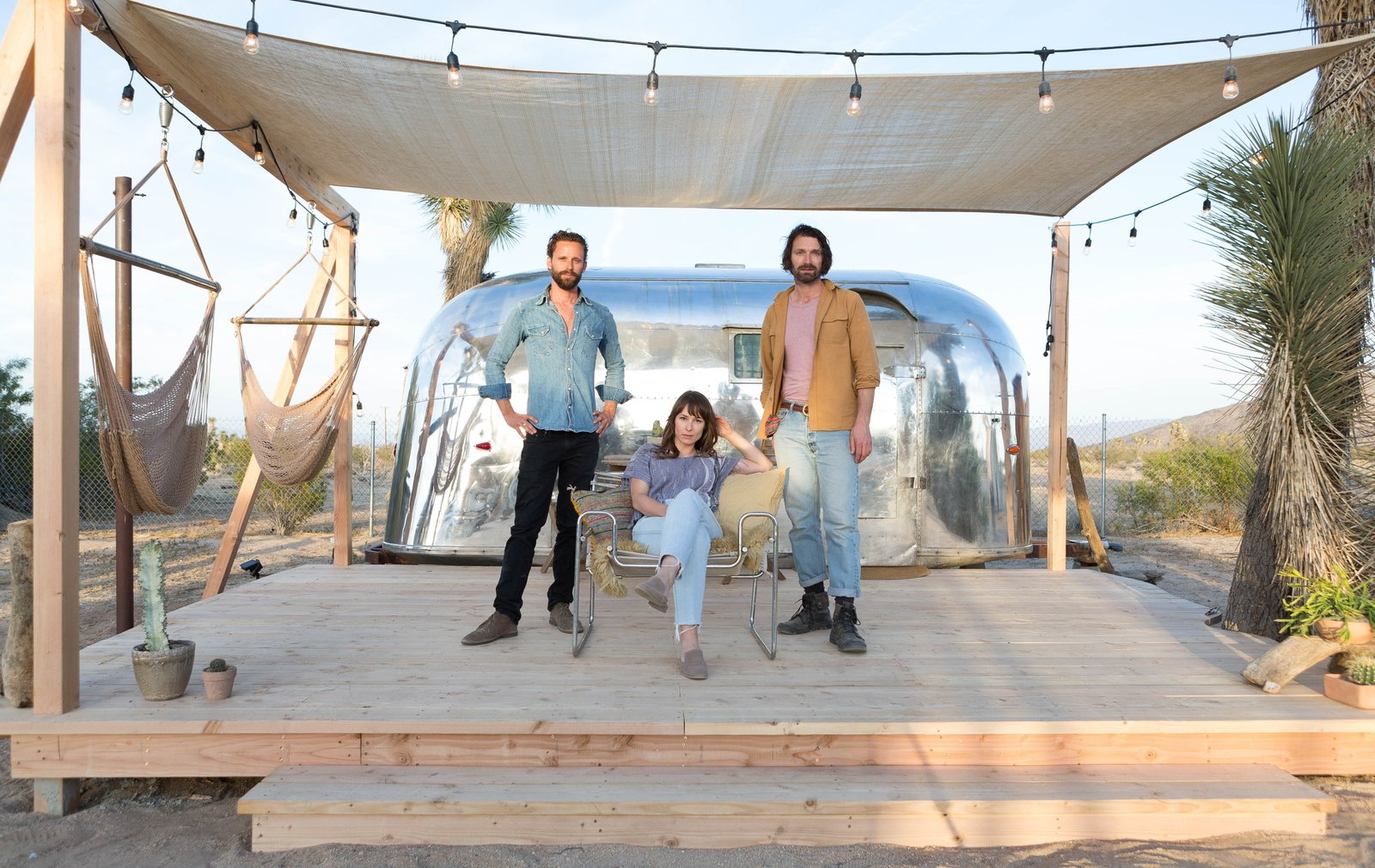 Exterior, Airstream Building Type, Metal Siding Material, Metal Roof Material, and Curved RoofLine Pictured from left to right: Andrew Uhlhorn, Justine Bennett, and Joseph August.  Photo 1 of 16 in Joshua Tree Is Now Home to a Chic Airstream Oasis—Featuring 4 Trailers Available to Rent