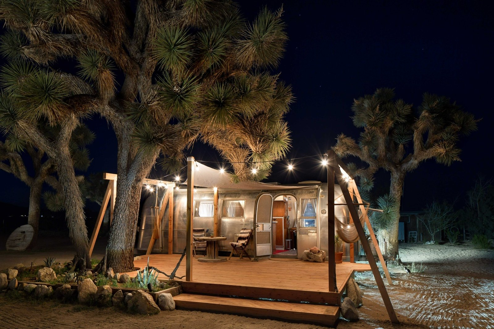 Exterior, Metal Roof Material, Airstream Building Type, Metal Siding Material, and Curved RoofLine The property is outfitted with solar-powered lights that automatically turn on at night.    Photo 4 of 16 in Joshua Tree Is Now Home to a Chic Airstream Oasis—Featuring 4 Trailers Available to Rent