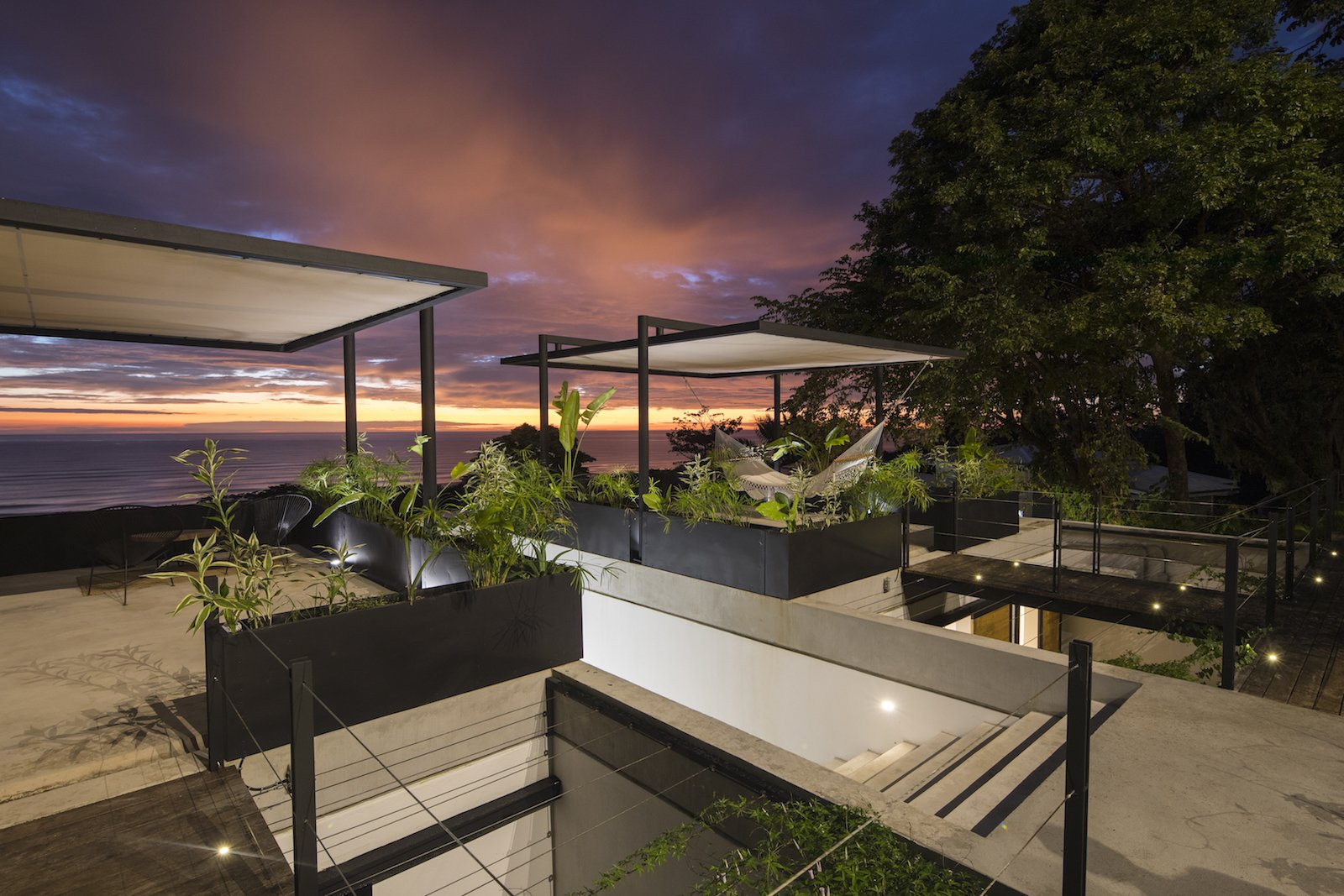 Outdoor, Shrubs, Rooftop, Concrete, Grass, Small, and Wire Mint's elevated location offers stellar sunset viewing.  Best Outdoor Rooftop Concrete Photos from Revive Your Mind at This Adults–Only Boutique Hotel in Costa Rica