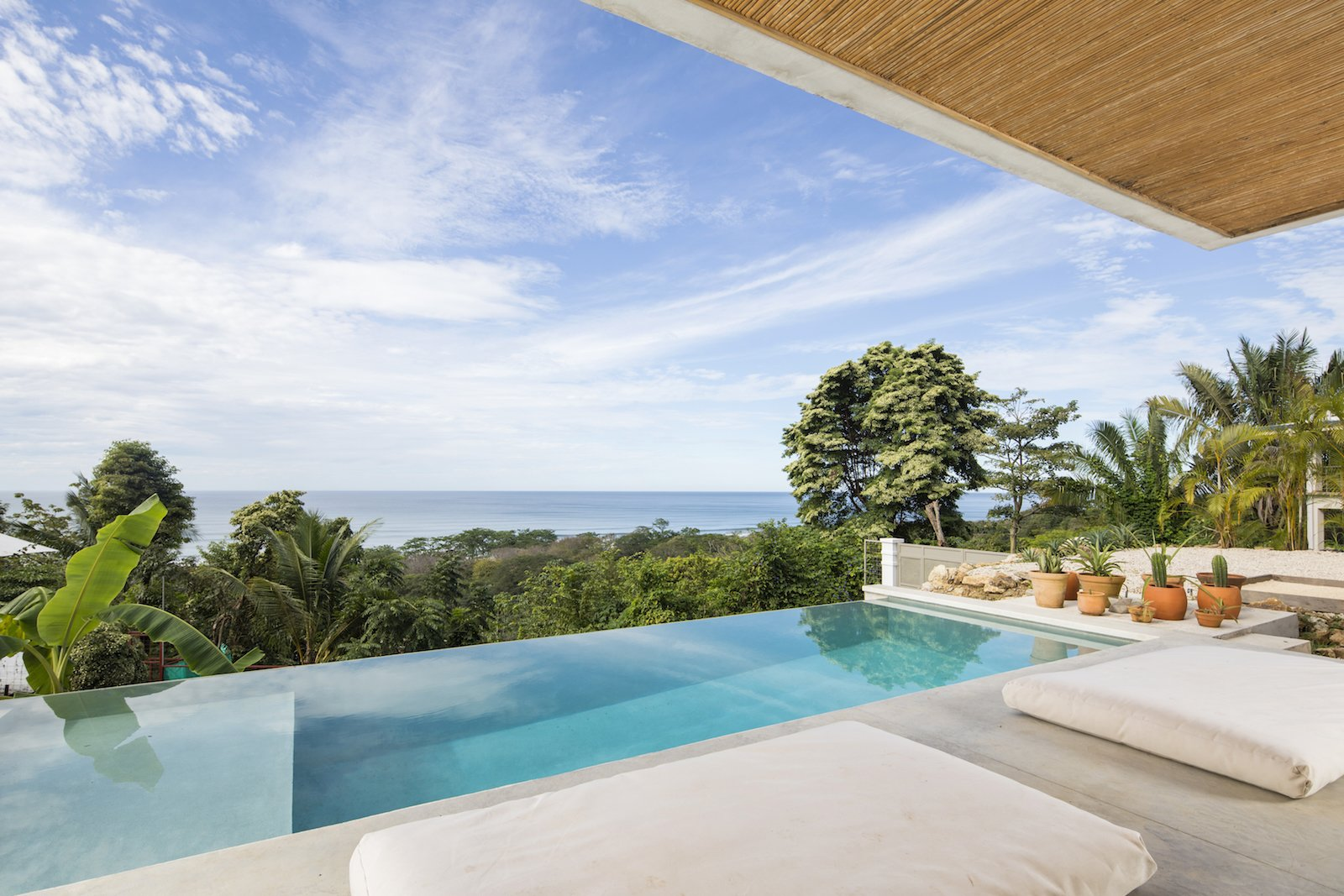 Outdoor, Infinity Pools, Tubs, Shower, and Concrete Patio, Porch, Deck The infinity pool mirrors the Pacific Ocean.  Photo 7 of 11 in Revive Your Mind at This Adults–Only Boutique Hotel in Costa Rica