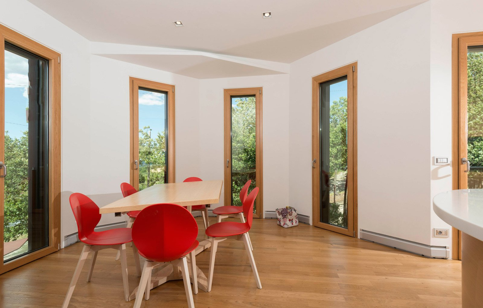 Dining Room, Chair, Table, Recessed Lighting, and Medium Hardwood Floor Operable glazed openings bring in natural light and ventilation to keep energy demands low.   Photo 3 of 8 in This Octagonal Prefab in Italy Rotates a Full 360 Degrees to Follow the Sun