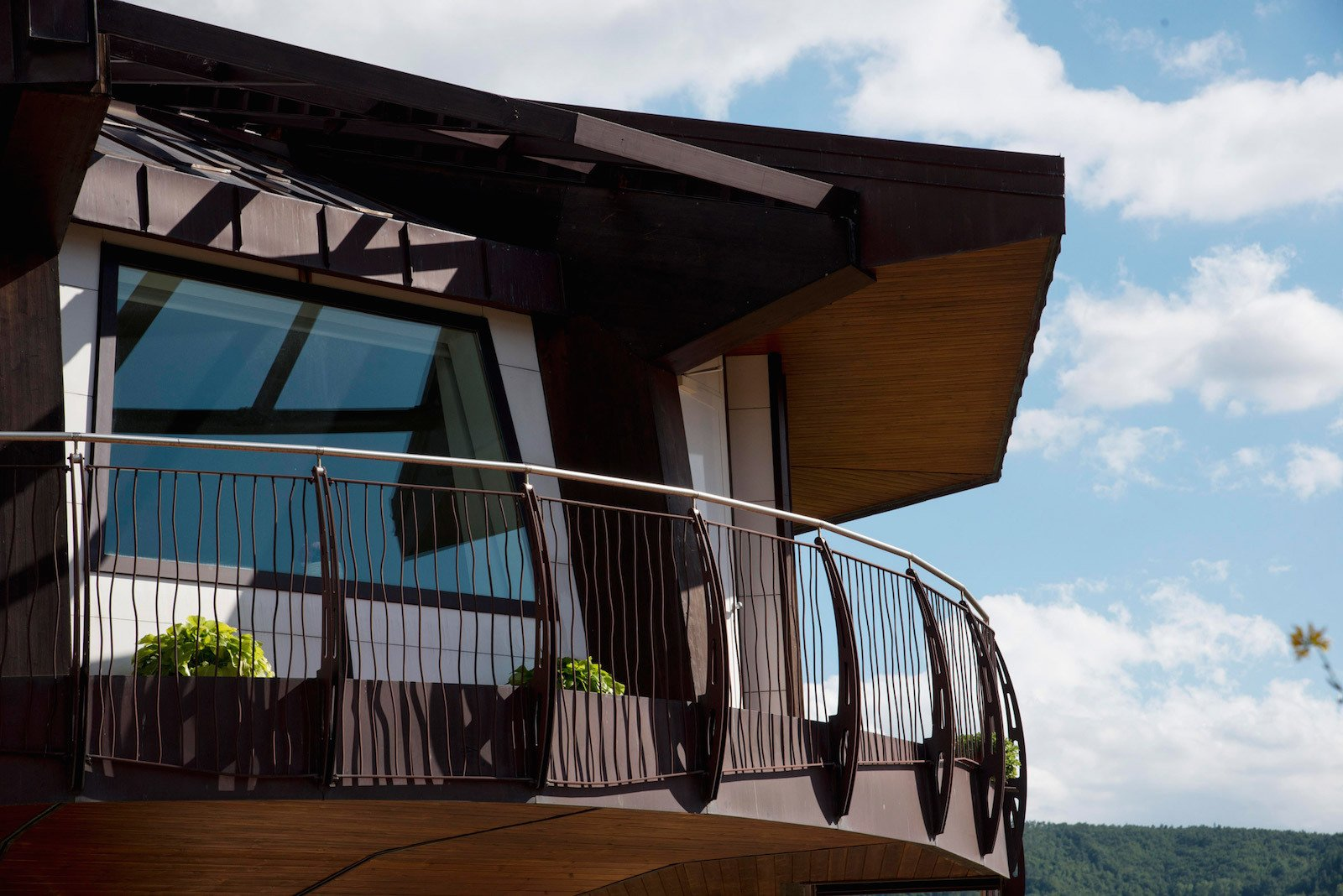 Exterior, Wood Siding Material, House Building Type, Metal Roof Material, and Prefab Building Type The living space extends to a protected outdoor terrace.  Photo 8 of 8 in This Octagonal Prefab in Italy Rotates a Full 360 Degrees to Follow the Sun