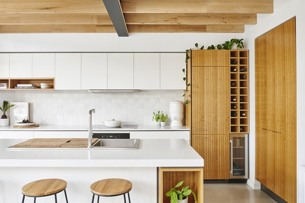 Cantilever Interiors designed and built the kitchen, which features ECO by Consentino kitchen countertops.
