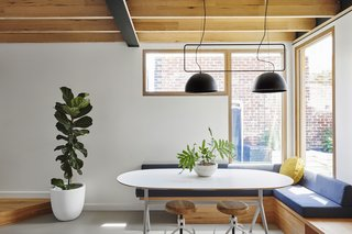 Filled with natural light and air-purifying plants, the two-bedroom abode boasts clean and contemporary character.