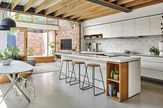 The kitchen features exposed Vic Ash Glulam beams sourced from Australian Sustainable Hardwoods.