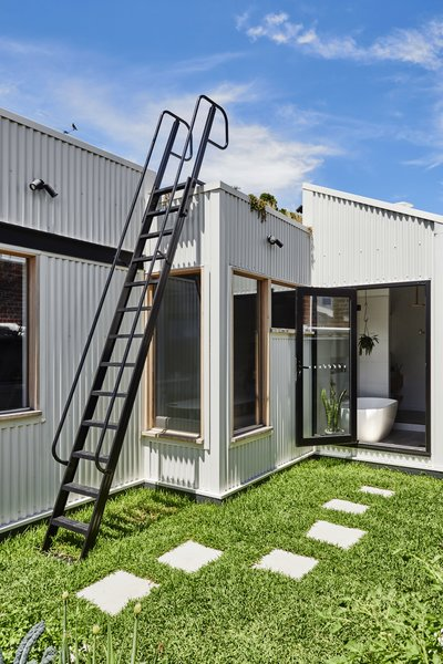 The extension is clad in Colorbond 'Surfmist.'
