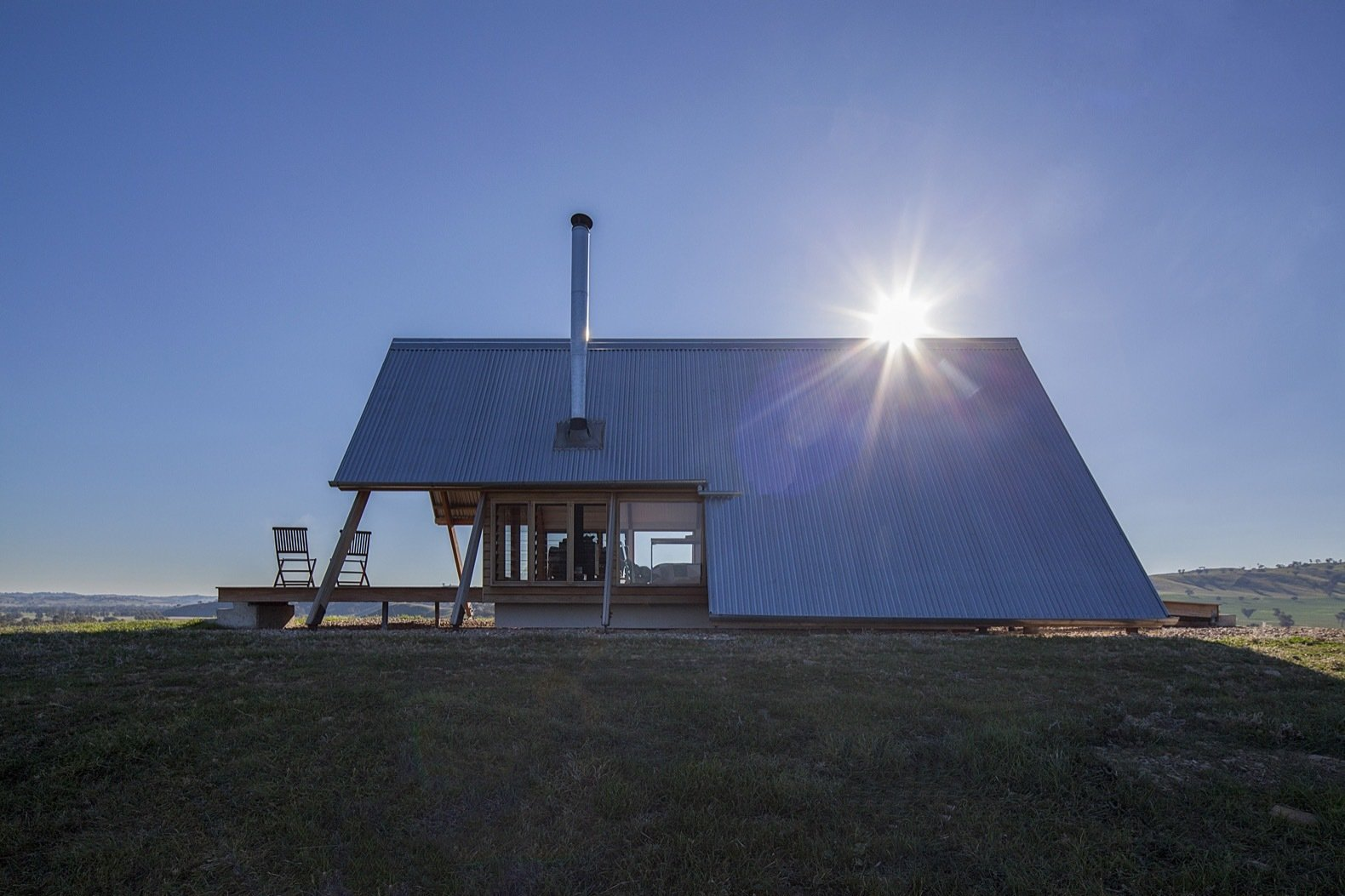 Exterior, Cabin Building Type, Wood Siding Material, Metal Roof Material, and A-Frame RoofLine Lightweight corrugated zinc roof sheeting clads the exterior.  Photos from This Elegant A-Frame Rental in Australia Lets You Reconnect With Nature in Style