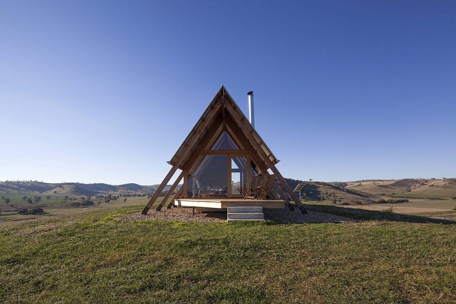 Exterior, Metal Roof Material, Wood Siding Material, Cabin Building Type, and A-Frame RoofLine David Ferguson of Kimo Estate took construction into his own hands in a two-person owner-builder team.   Photos from This Elegant A-Frame Rental in Australia Lets You Reconnect With Nature in Style
