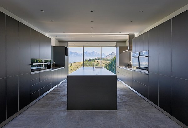 Bulthaup kitchen cabinets are complemented with quartzite and stainless steel countertops.
